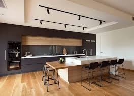 modern kitchen island useful items double as decor in this modern kitchen avi