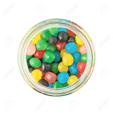 glass jar full of colorful candy ball sweets composition isolated