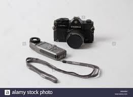 film camera light meter 35 mm film camera and light meter on white background stock photo