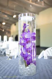 purple centerpieces centerpieces floating candles and vase on gladiolas