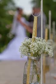 wedding sand ceremony vases baby u0027s breath in mason jars hung with gold ribbon gorgeous