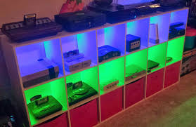 video game console shelves with colored lighting via reddit user