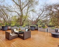 decorating beautiful deck with wood flooring and outdoor