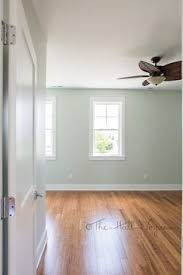 sherwin williams sea salt paired with honey colored oak wood