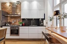 modern looking kitchens kitchen white themed modern kitchen with brick wall accents also
