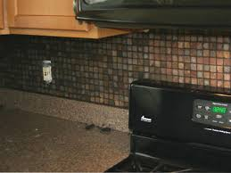 How To Install Glass Mosaic Tile Backsplash In Kitchen Installing Kitchen Tile Backsplash Hgtv