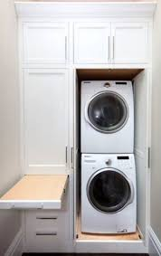 washer and dryer cabinets hidden cabinet hiding in for law suite