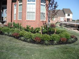 front home flower bed with boxwoods hedge and flower shrubs by