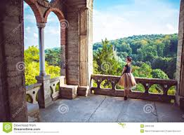 balconey young charming lady in vintage dress on the balcony of the castle