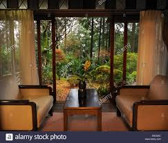 chairs on a japanese ryokan room with open sliding door and a