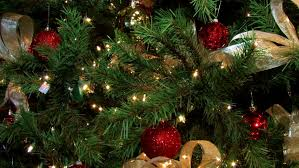 tree decorated with blinking lights balls and golden