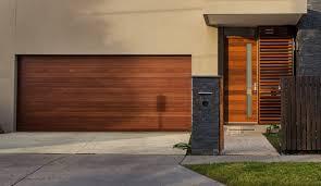 full custom stain grade wood garage door in clear western red nice brown square unique wood door weather stripping varnished design