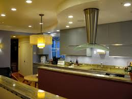 led under the cabinet lighting craftsman style kitchen island transitional with chrome pendant