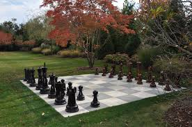 giant teak chess set in a lovely hamptons backyard