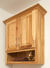 wooden mounted cabinet with two glass doorwall display cabinets