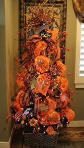 Fall Tree Decorations Pumpkin Topiaries That I Made Using Tomato Stakes And Deco Mesh
