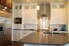 stainless steel kitchen cabinet with backsplash and pendant light