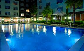 bell city swimming pool at night melbourne hotel accommodation