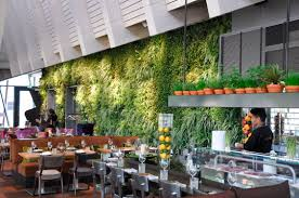 sophisticated restaurant interior design with green wall as well