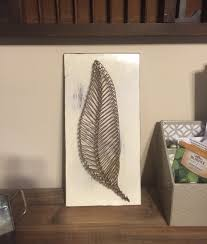 feather or leaf nail and string art on wood by molliespaintings