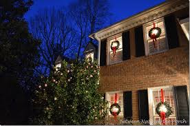 Christmas Decorations For A Barn by Front Porch Decorated For Christmas With Three Wreaths On Door And