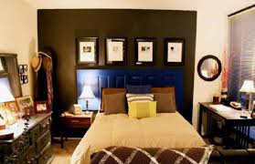 bedroom small apartment decor with wall photos and navy blue