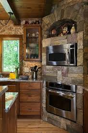 rustic stone and log homes modern stone and log homes rustic home decor still has modern elements such as appliances and