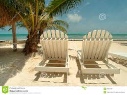 Chairs On A Beach Chaise Lounge Chairs On A Tropical Beach Stock Photo Image 5565790