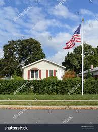 bungalow home american flag suburban bungalow home blue stock photo 728796910