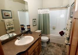 decorating ideas for small bathrooms in apartments beige wooden laminate shelves wooden corner blind curtain apartment