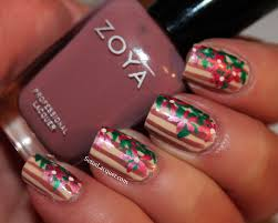 floral nail art on striped background set in lacquer