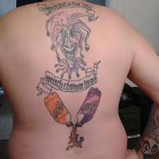 the joker upper back and cola bottle lower back tattoo nfsw