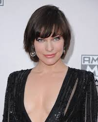 shortcut for black hair milla jovovich short haircut with bangs for curly hair in casual