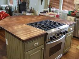 Wood Top Kitchen Island by Kitchen Island With Stove Top Including Cabinet Design