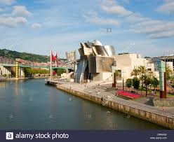 the guggenheim museum and the nervion river in the city of bilbao