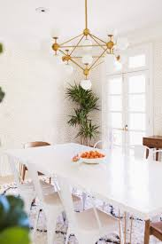 elsie s dining room refresh autumn 2017 a beautiful mess sources wallpaper juju papers chandelier shop candelabra rug marrakesh shag rug from rugs usa mirror rejuvenation white chairs amazon