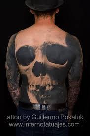 fabulous skull back tattoos by guillermo pokaluk