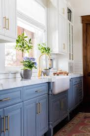 white cabinets on top blue on bottom blue bottom cabinets and white top cabinets transitional
