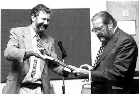 Clive Gamble presenting the volume to John Wymer © Cath Price - p03009