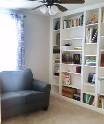 Sliding Bookcase Murphy Bed A 37 Year Old Woman Lays A Bookshelf On The Floor The Next Night
