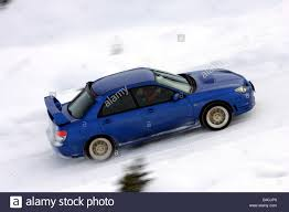 subaru rally snow subaru impreza 2 5 wrx sti model year 2005 blue moving side
