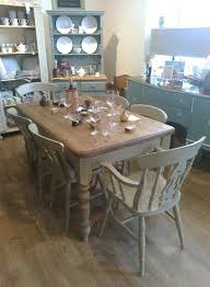 shabby chic farmhouse style table with 4 fiddleback chairs and 2