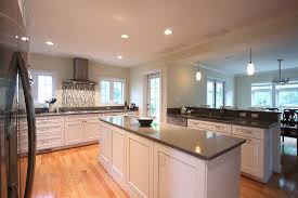 white kitchen cabinets with oak floors white kitchen oak floors american traditional kitchen