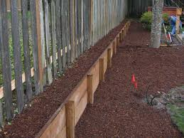 long raised bed great way to go vertical along fenceline property