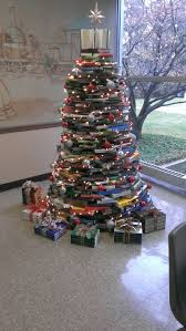 my work made a christmas tree out of books mildlyinteresting