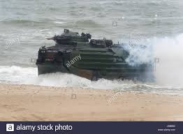 amphibious vehicle an american assault amphibious vehicle aav 7 is landing on the