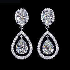 boucle d oreille mariage d oreilles plaque or blanc forme goutte halo elegance zirconium