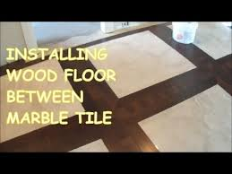 Installing Prefinished Hardwood Floors How To Install Prefinished Hardwood Floor Around Tile Marble Tile