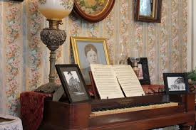 the lizzie borden house tour the macabre new england today a portrait of lizzie rests on the parlor piano the lizzie borden house
