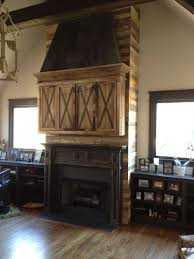 handmade fireplace installation mantle media cabinet reclaimed